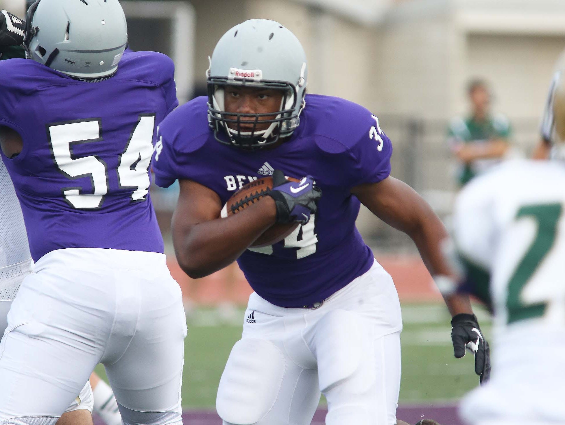 LeShawn Johnson of Ben Davis runs through a hole in the line. Ben Davis hosted Westfield in a football scrimmage Friday August 15, 2014.