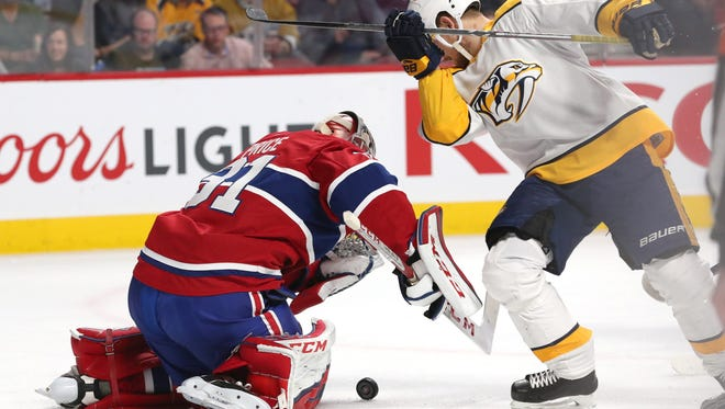 Feb 10, 2018; Montreal, Quebec, CAN; Montreal Canadiens goaltender Carey Price (31) makes a save against Nashville Predators left wing Viktor Arvidsson (33) during the first period at Bell Centre. Mandatory Credit: Jean-Yves Ahern-USA TODAY Sport