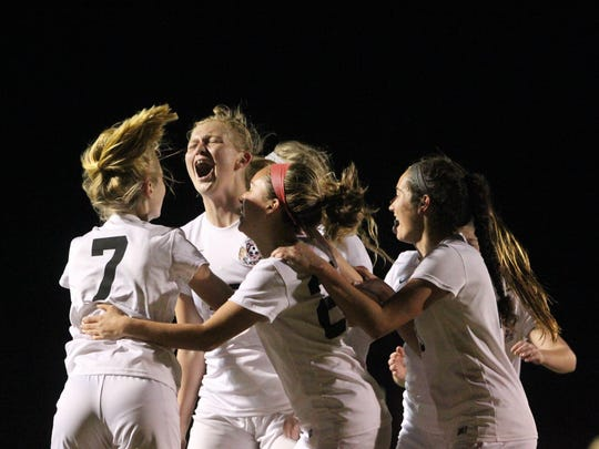 Leon's Kate Carter celebrates with her teammates after a goal.