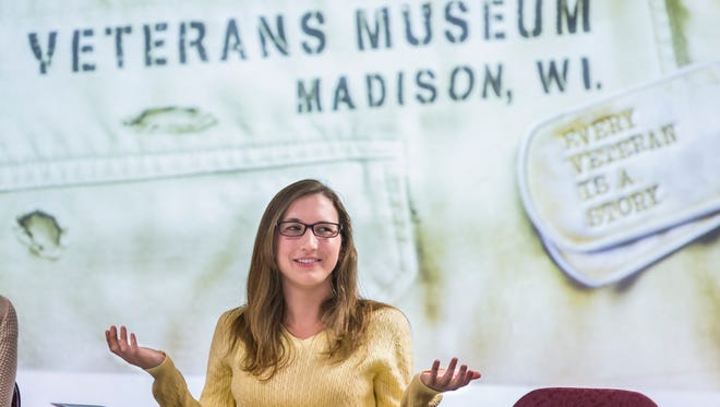 """Molly Harris, a UW Ph.D student, moderates a discussion of the book """"Ceremony"""" by Leslie Marmon Silko at a meeting of the Warrior Book Club at the Wisconsin Veterans Museum in Madison."""