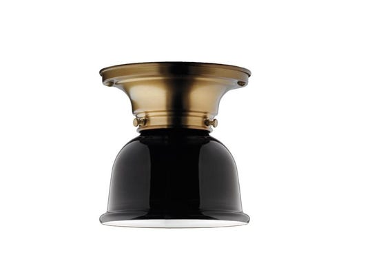 The Thurman flush-mount light comes in nine finishes and 66 shade options ($150, rejuvenation.com). The Old Brass and Metal Dome Shade in gloss black (shown) is a striking combination.