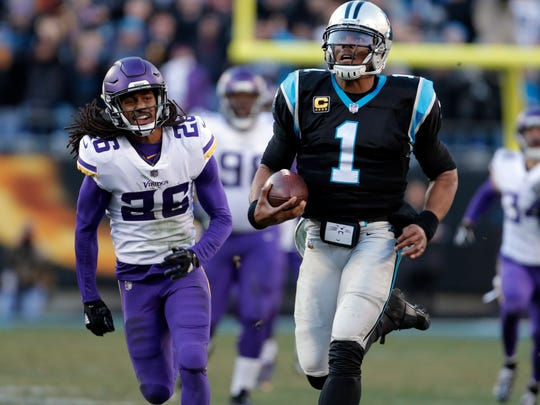 Carolina Panthers' Cam Newton (1) runs for a long gain as Minnesota Vikings' Trae Waynes (26) pursues during the second half of an NFL football game in Charlotte, N.C., Sunday, Dec. 10, 2017. (AP Photo/Bob Leverone)
