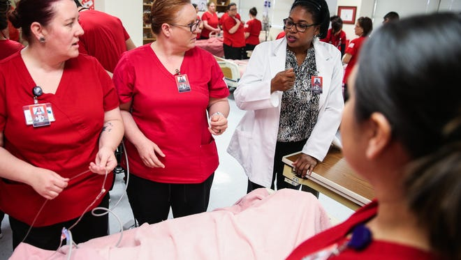 Howard College instructor and registered nurse Nickette Surgeon, right, answers questions from students Thursday, Jan. 25, 2018, at St. John's campus of Shannon Medical Center.