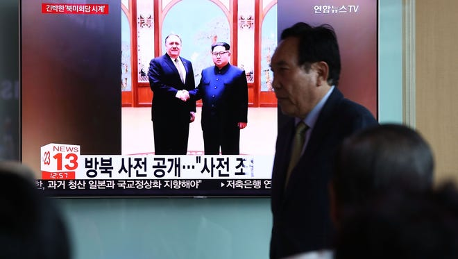 South Koreans watch on a screen reporting U.S. Secretary of State Mike Pompeo's visit to North Korea at the Seoul Railway Station in Seoul.