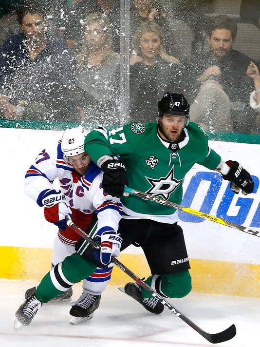 New York Rangers defenseman Ryan McDonagh (27) and Dallas Stars right wing Alexander Radulov (47) collide during the third period of an NHL hockey game Monday, Feb. 5, 2018, in Dallas. The Stars won 2-1. (AP Photo/Ron Jenkins)