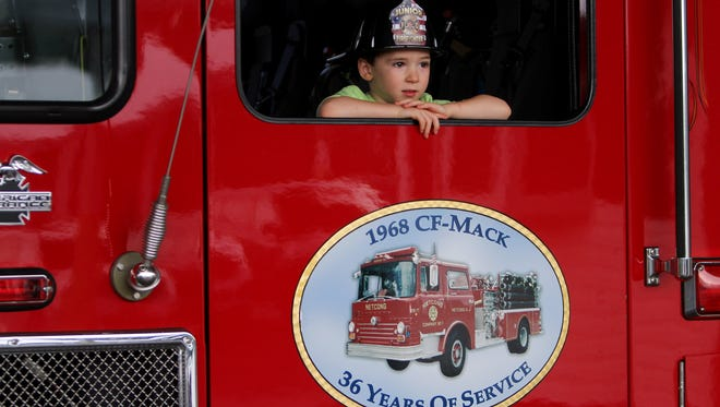 3-year-old Charlie DeLiso of Morris Plains take a look out of a Netcong fire truck during the Park Police of Morris County and the Morris County Park Commission's annual National Night Out at Mennen Arena. August 1, 2017. Morris Twp., NJ