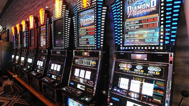 Slot machines line the walls at the Tiverton Casino.