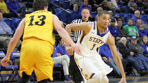 South Dakota State's Skyler Flatten (1) drives to the lane past Wayne State's Austin Esters during the second half of the Jackrabbits' 80-72 victory over the Wildcats Wednesday night at Frost Arena in Brookings.
