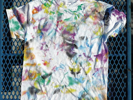 Robin Zielinski   Sun-News Pictured is a spray painted T-shirt made using a tie-dye inspired technique.