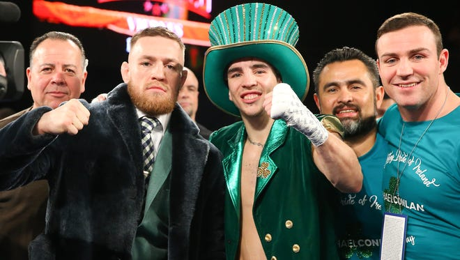 Conor McGregor and Michael Conlan celebrate Conlan's 3rd round TKO win over Tim Ibarra in his super bantamweight bout at The Theater at Madison Square Garden.