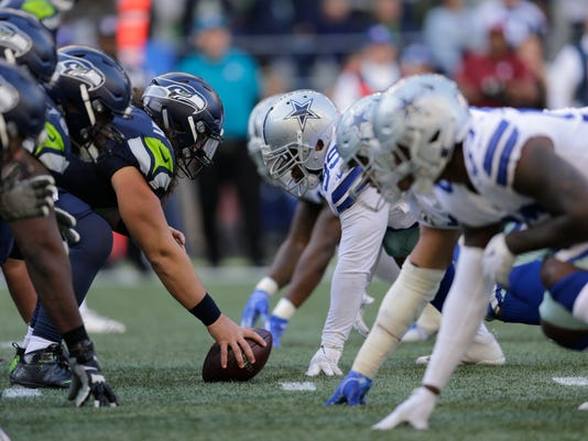 offensive line Cowboys Seahawks Football