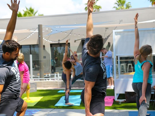 The Moxy Tempe hosts NamaStay yoga by the pool through the summer.