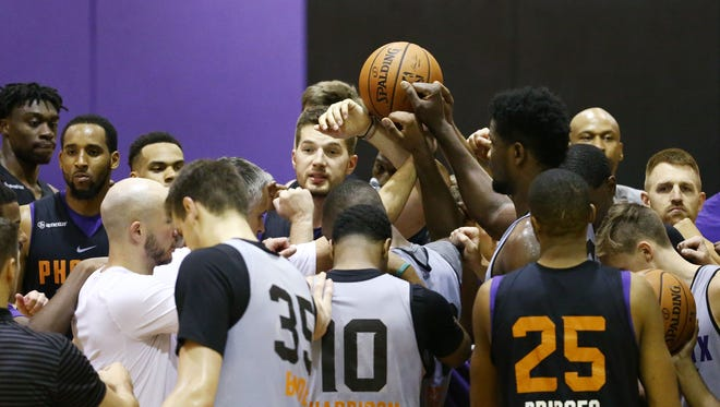 Phoenix Suns huddle during practice on July 5, 2018 at Taking Stick Resort Arena in Phoenix, Ariz.