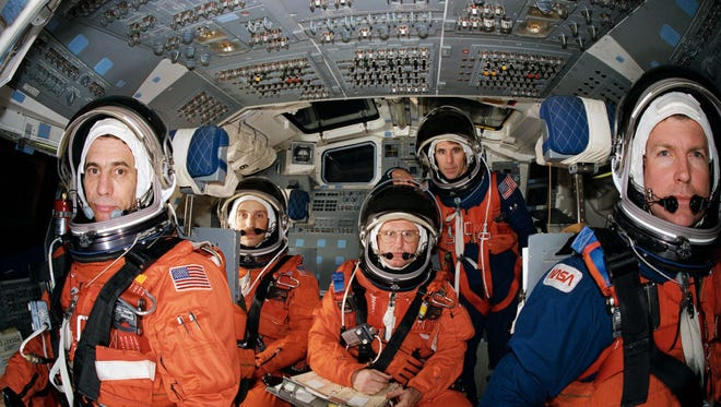 STS-29 Discovery crew members, wearing launch and entry suits, participate in training exercises in February 1989. Mission specialist Robert C. Springer, second from left, will speak at a Stearns History Museum gala May 11.