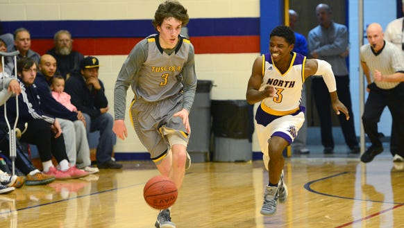 North Henderson's Anthony Westhusing, left, and North