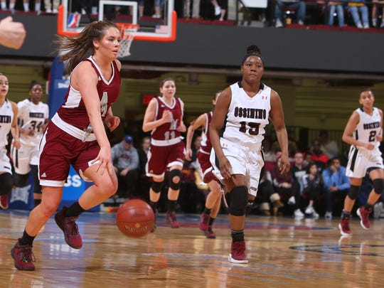 Albertus Magnus' Mairead Durkin brings the ball up during the Section 1 Class AA girls basketball championship against Ossining at the Westchester County Center.