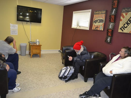 Guests hang out in the TV room at The Micah Center