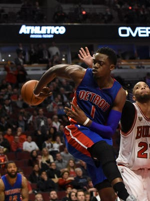 Pistons guard Reggie Jackson (1) looks to pass around Bulls center Pau Gasol (16) during the second overtime of the Pistons' 147-144 four-overtime win over the Bulls Friday in Chicago.