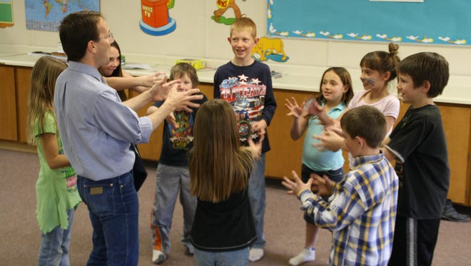 Michael Bahr, Education Director for the Utah Shakespeare Festival engages students involved in Playmakers Summer Shakespeare.