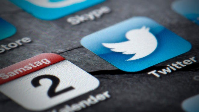 FILE - OCTOBER 27, 2014: It was reported the shares of Twitter are down as much as 8 percent after the company reported its third quarter earnings October 27, 2014. NEW YORK, NY - NOVEMBER 07:  The Twitter logo is displayed on a banner outside the New York Stock Exchange (NYSE) on November 7, 2013 in New York City. Twitter goes public on the NYSE today and is expected to open at USD 26 per share, making the company worth an estimated USD 18 billion.  (Photo by Andrew Burton/Getty Images) ORG XMIT: 503816393 ORIG FILE ID: 187232512