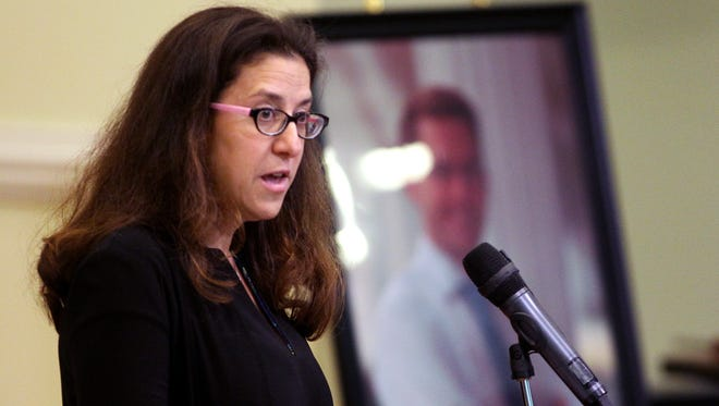 Shelly Markel speaks about her younger brother Dan Markel, slain Florida State University College of Law professor Dan Markel in a memorial for him at FSU Tuesday. Markel, 41, was shot in his Betton Hills garage July 18 and died the next day.