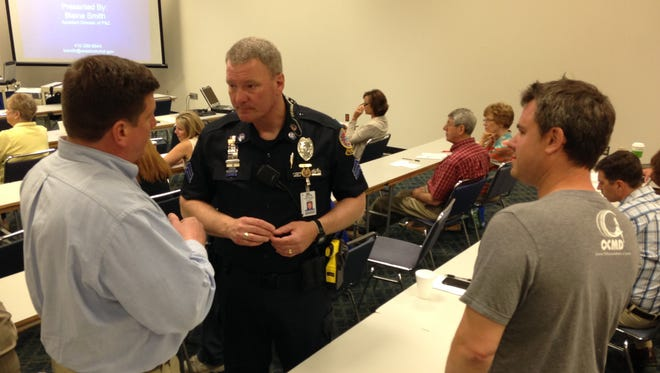 Ocean City Councilman Wayne Hartman (left) talks with Ocean City Police Department Sgt. Mark Paddack Tuesday while landlord Aaron Evans listens during a workshop at the Roland E. Powell Convention Center.