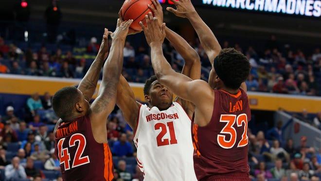 Badgers guard Khalil Iverson shoots against Virginia Tech defenders.