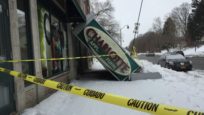 A snow buildup last winter led to the Charlotte Appliance marquee's fall onto the sidewalk below.