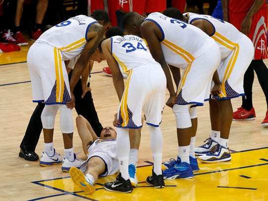 Golden State Warriors guard Klay Thompson, bottom,