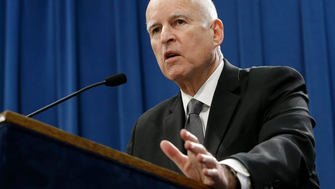 Gov. Jerry Brown discusses his proposed 2015-16 state budget plan at a news conference in Sacramento on Friday, Jan. 9, 2015.