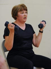 Nancy Olson of Lewes, at her exercise class at Midway Fitness in Rehoboth Beach. Nancy takes an exercise class to help manage her Parkinson's.