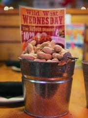 A bucket of peanuts at Texas Roadhouse in Muncie in 2013.