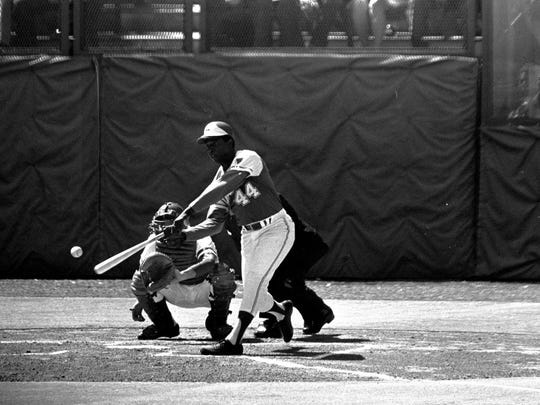 Hank Aaron starts his swing in the first inning on  April 4, 1974, as he hit his 714th career home run to tie the all-time record set by Babe Ruth.
