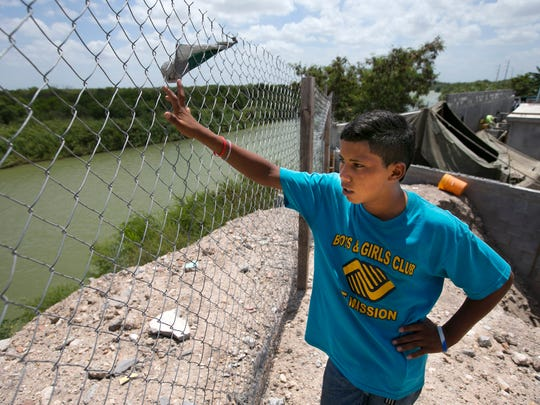 Brayan Duban Soler Redondo, 14, of Quebrada Maria San Luis Conayagua, Honduras, looks out on the Rio Grande river separating Mexico from Texas, at the Senda de Vida, a shelter for migrants in Reynosa, Mexico, on Thursday, June 19, 2014. Brayan left Honduras in mid April to reach the United States. He does not have the money they need to pay the smugglers to cross into the United States.