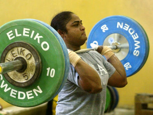 Indian weightlifter Karnam Malleswari trains to compete in the Athens Olympics.