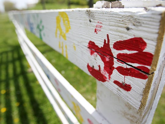 Chaucie's Place is a Hamilton County child advocacy center in Carmel, Ind.  In front of the property are parts of an old fence that was at the former site for Chaucie's Place, an old farmhouse.  Handprints on the fence are from children who had come to the center.