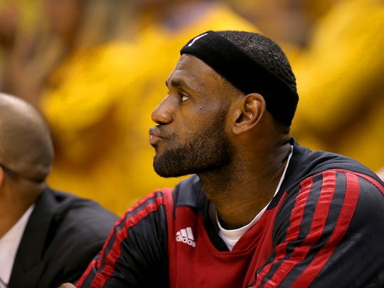 Miami Heats LeBron James (6) sits on the bench with five fouls during the second half of action. The Indiana Pacers hosted the Miami Heat in Game 5 of the NBA Eastern Conference Finals Wednesday, May 28, 2014, at Bankers Life Fieldhouse in Indianapolis.