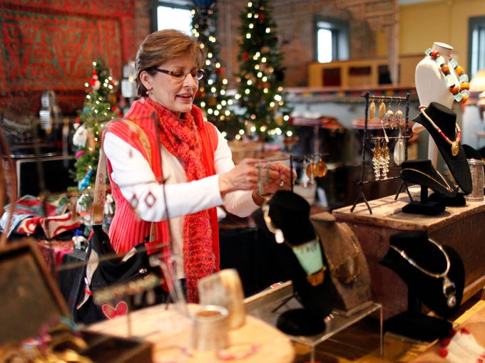Kim Rougeux shops at Canoe, a locally owned store located in the NuLu area of Louisville.  Dec. 4, 2013