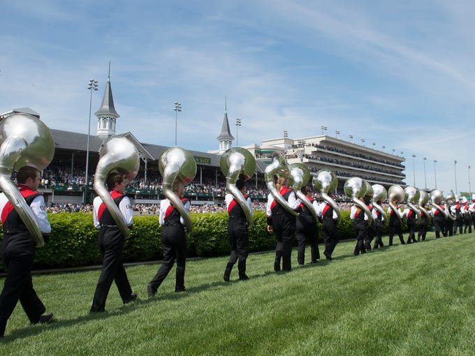 The University of Louisville Cardinal Marching band walks out to perform for the Derby crowd at Churchill Downs. May 3, 2014