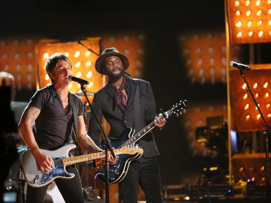 "Keith Urban, left, and Gary Clark Jr. perform ""Cop Car"" onstage at the 56th annual Grammy Awards on Sunday at the Staples Center in Los Angeles.  Matt Sayles / Invision / AP Keith Urban, left, and Gary Clark, Jr. perform ""Cop Car"" on stage at the 56th annual Grammy Awards at Staples Center on Sunday, Jan. 26, 2014, in Los Angeles."