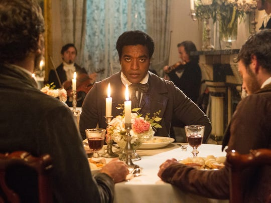 """Chiwetel Ejiofor portrays Solomon Northup in the Oscar-nominated film """"12 Years A Slave,"""" the true story about a free Black man who was kidnapped into slavery in 19th-century America"""