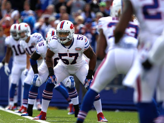 Ty Powell gets ready for the punt on Sunday, September 14, 2014. Buffalo beat Miami 29-10