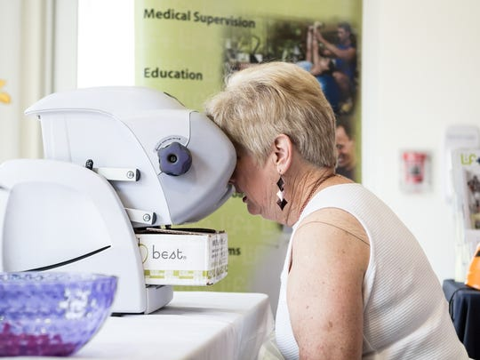 In this file photo, Margaret Anne Lucas goes through vision screening during the Neighborhood Health Fair at the Lift Wellness Center.