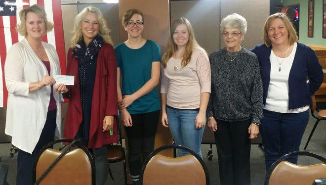 Cris Morreale of the Pennfield Exchange Club presents a check for $1,000 to Pennfield High School teacher Kristin Nolan, co-chair of Adventure In Spain 2016. To Nolan's left are students Bethany Behrens and Kayla Madsen, Exchange Club member Judy Montych, and Adventure co-chair Carla Behrens.