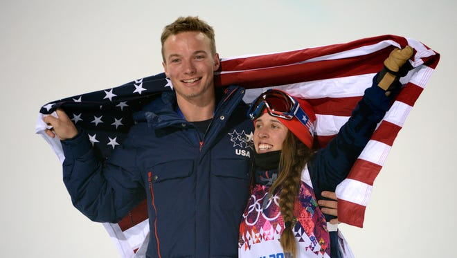 Maddie Bowman (USA) celebrates winning gold in the ladies' ski halfpipe final with David Wise (USA) who won gold in the men's ski halfpipe during the Sochi 2014 Olympic Winter Games at Rosa Khutor Extreme Park.