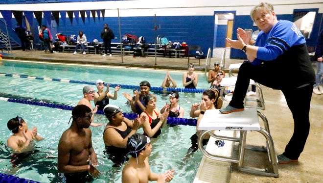 Coach Amy Caulkins cheers on swimmers going to state during La Vergne's practice on Wednesday, Jan. 24, 2018, at La Vergne.