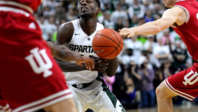 Spartans guard Eron Harris (14) losses the ball to an Indiana defender in the first half against Indiana Sunday, Feb. 14, 2016 in the Breslin Center in East Lansing.