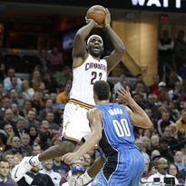Cleveland Cavaliers' LeBron James (23) shoots over Orlando Magic's Aaron Gordon (00) in the first half of an NBA basketball game Monday, Nov. 23, 2015, in Cleveland.