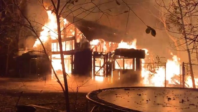 Flames engulf a barn at 8758 E. State St. in Rockford on Thursday, Oct. 29, 2020. This image comes from video posted on Twitter by Rockford Fire Department.