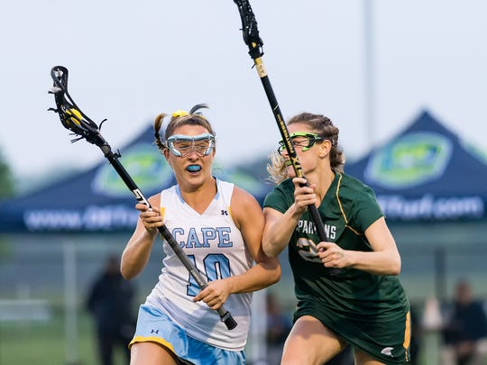 Cape Henlopen's Annie Judge (10) tries to get the ball by St. Mark's Kendra Schweizer (21) in the DIAA Girls Lacrosse championship game at DE Turf Sports Complex in Frederica.